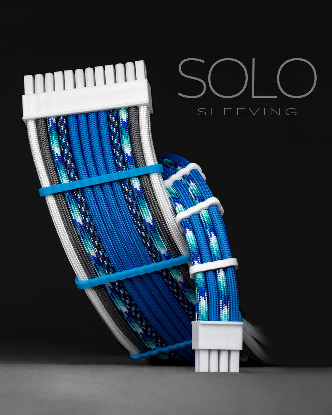 Custom sleeved blue and white paracord extension cables